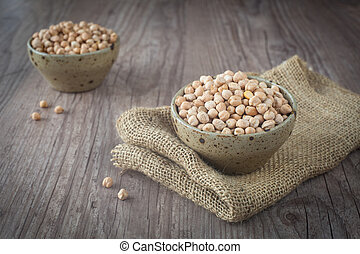 Chickpeas - Bunch of chickpeas in a bowl on a wooden...