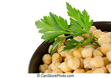 Chickpeas in a brown bowl, isolated over white background.