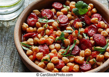 Chickpeas with chorizo in a clay bo