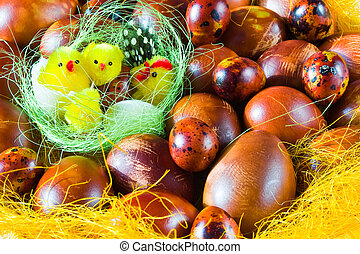 chicks in basket with easter eggs