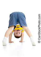 chid boy upside down
