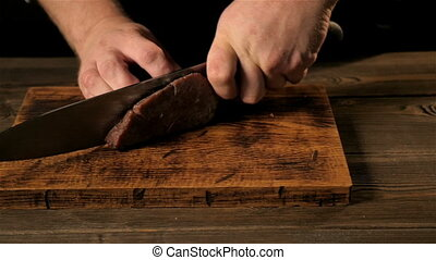 Chief Cutting Beef On Cutting Board, Close - Up Shot - Chief...