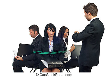 Chief force employees to work - Businessman looking at his ...