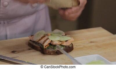Chief Making Sandwich. Handheld shot