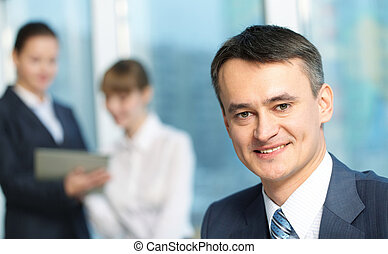 Chief manager - Portrait of a mature smiling manager against...