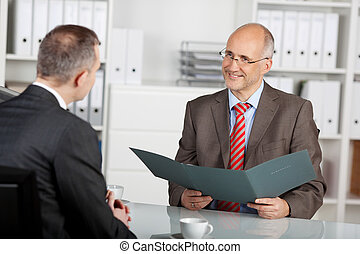 Chief of staff reviewing information of applicant - Chief of...