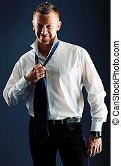chief - Portrait of a handsome man in a suit. Studio shot.