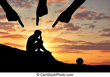 Child abuse and violence. Silhouette of a sad boy and hands of an adult people pointing at him