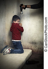 Child abuse victim - Abused child, curled up on a mattress...