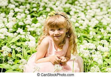 child among white flowers
