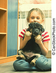 child and a German Shepherd puppy