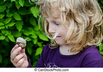 child and a snail