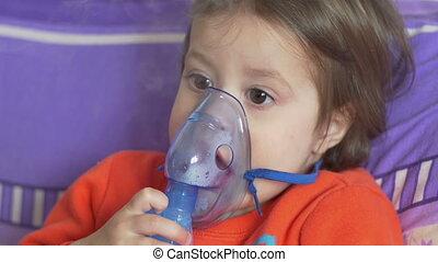 Child and Breath Nebulizer - Little child is taking medicine...