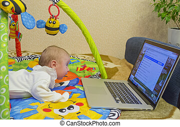 Child and computer - The child crept up to the computer and...