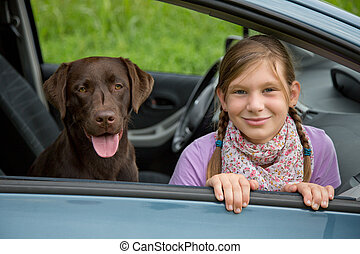 Child and dog in a car