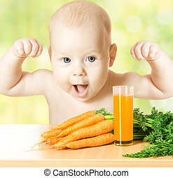 Child and fresh carrot juice glass. Concept: healthy...