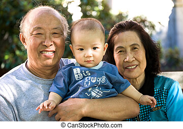 Child and grandparents - A shot of an asian child spending...