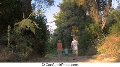 Child and grandparents running in the forest