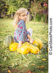 child and pumpkins