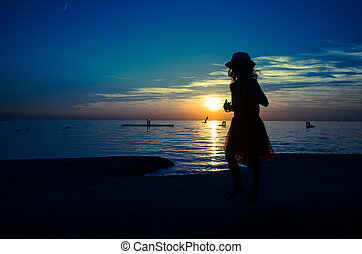 child and sunset in the horizon