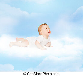 smiling baby lying on cloud and looking up