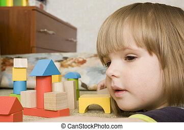 child and toy blocks