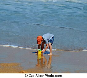 child at play on beach