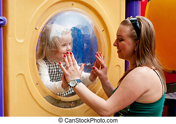 Child at play with mother