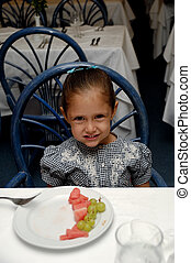 child at restaurant table