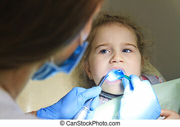 Child at the dentist,little girl and doctor