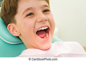Photo of youngster with his mouth wide open during checkup at the dentist?s