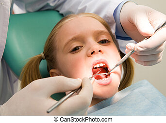 Child at the dentistry - Photo of small girl looking at...