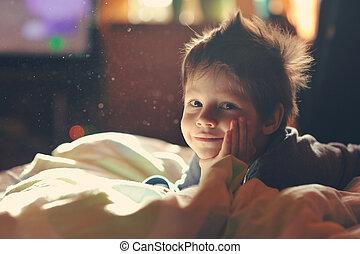 child awake - child from sleep lying on the sofa and...