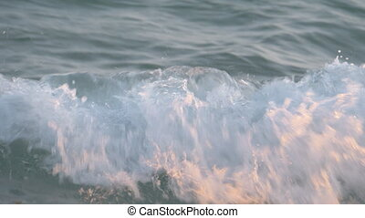 Child bathing in the sea and catching strong waves