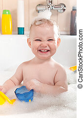 Child bathing - Little baby girl having soapy bath at home