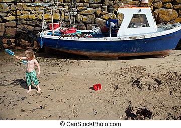 Child beach harbor Cornwall boat Mousehole