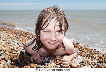 child beach sunbathing relaxing