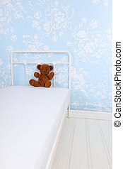 Child bedroom with stuffed bear