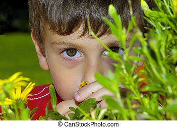 Child Behind a Plant