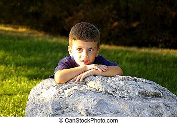 Child Behind Rock 2