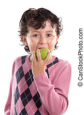 Child biting an apple - Child with pink jersey biting an...
