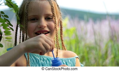 Child blow bubbles - Little girl blow bubbles