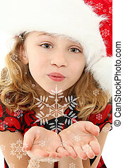 Child Blowing Snowflakes - Beautiful seven year old girl in...