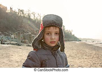 child boy at sea shore portrait outdoor