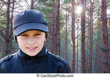 child boy backlight portrait pine forest outdoor