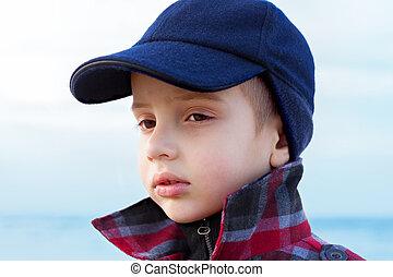 child boy close up fashion portrait upturned collar outdoor