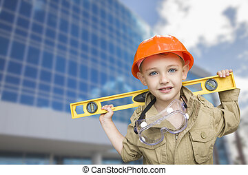 Child Boy Dressed Up as Handyman in Front of Building