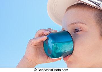 child boy drink water outdoor