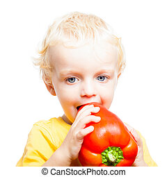 Child boy eating sweet pepper