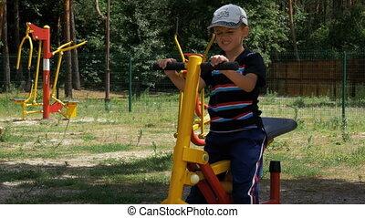 Child Boy Engaged on Sports Training Simulator at the...